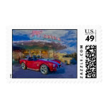 red sports car at drive-in stamps