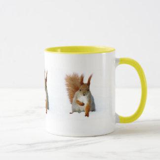 Red Squirrel sitting on snow Mug
