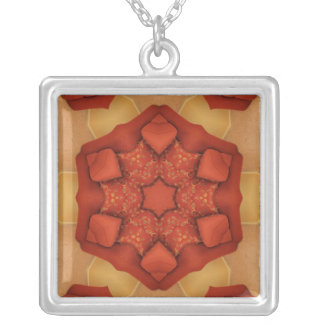 Red star design on red and tan square pendant necklace