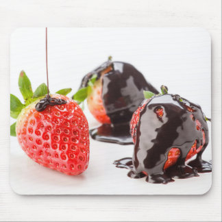 Red strawberries covered with chocolate mouse pad