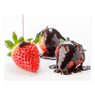 Red strawberries covered with chocolate postcard
