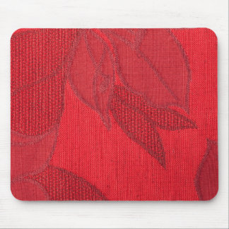 Red strings forming a flower on a red base mouse pad