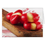 Red striped tea towel in background. greeting card