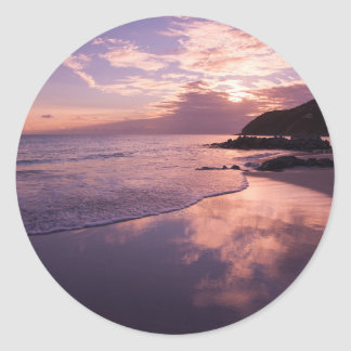 Red sunset, the clouds, the beach classic round sticker