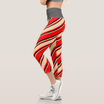 [ Thumbnail: Red, Tan, and Black Striped/Lined Pattern Leggings ]