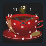 "Red Tea or Coffee Cup Kitchen Wall Clock<br><div class=""desc"">This clock features a photo of a red cup of coffee with a whimsical polka dot pattern.  A great clock for coffee lovers and looks great in the kitchen,  cafe or coffee shop.</div>"
