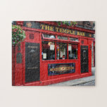 """Red Temple Bar pub in Dublin puzzle<br><div class=""""desc"""">Jigsaw puzzle of the famous red pub with the hanging flowers baskets in Temple Bar district in Dublin,  the capital of Ireland.</div>"""