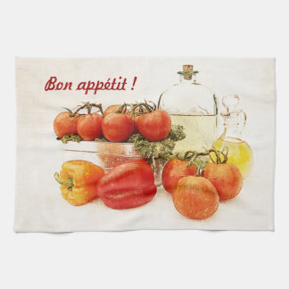 red tomatoes and vegetable oil kitchen towel