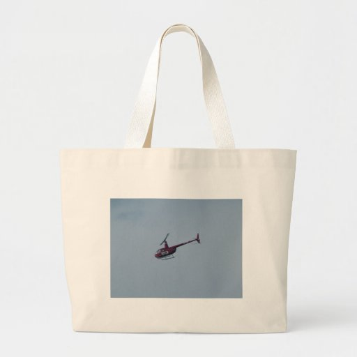 Red tourist helicopter. canvas bags