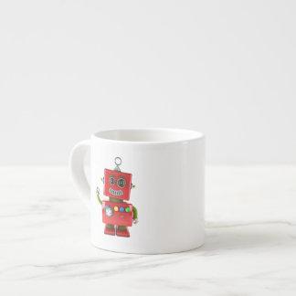 Red toy robot waving hello espresso cup