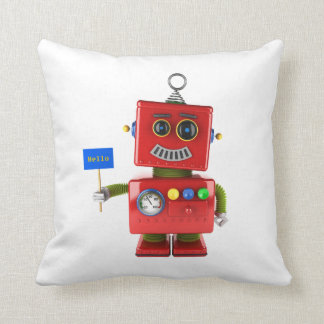 Red toy robot with hello sign pillow