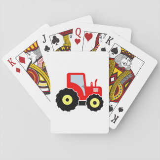 Red toy tractor playing cards