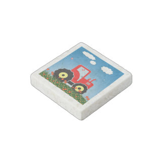 Red toy tractor stone magnet