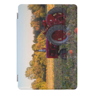 Red tractor in a field of pumpkins iPad pro cover
