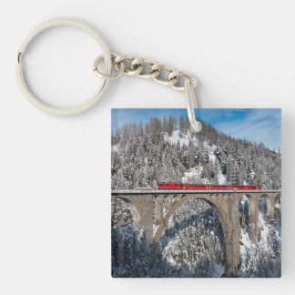 Red Train Pine Snow Covered Mountains Switzerland Keychain