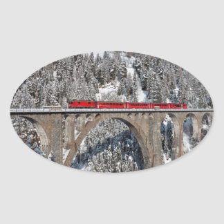 Red Train Pine Snow Covered Mountains Switzerland Oval Sticker
