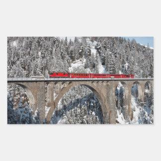 Red Train Pine Snow Covered Mountains Switzerland Rectangular Sticker