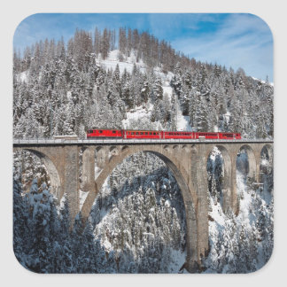 Red Train Pine Snow Covered Mountains Switzerland Square Sticker