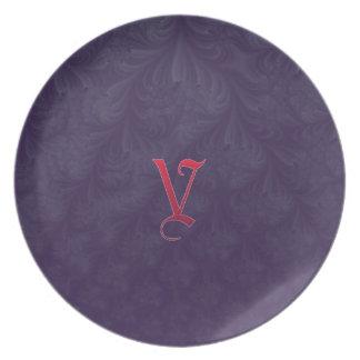 Red 'V' on purple embossed effect 3D fractal. Plates