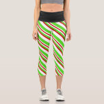 [ Thumbnail: Red, White, Green Christmas-Themed Lined Pattern Leggings ]