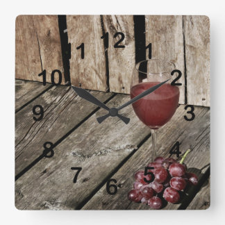 Red wine glass and grapes on wood texture square wall clock