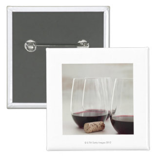 Red wine in stemless glasses button