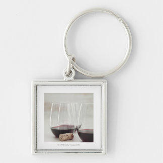 Red wine in stemless glasses keychains