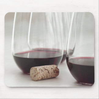 Red wine in stemless glasses mouse pad