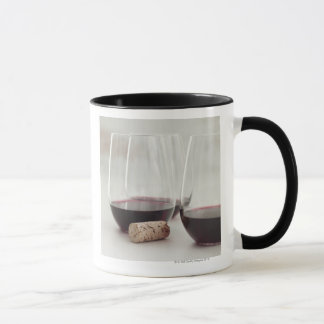Red wine in stemless glasses mug