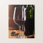"Red Wine Jigsaw Puzzle<br><div class=""desc"">Nice photo of wine bottles on a table. Great gift for wine lovers.</div>"