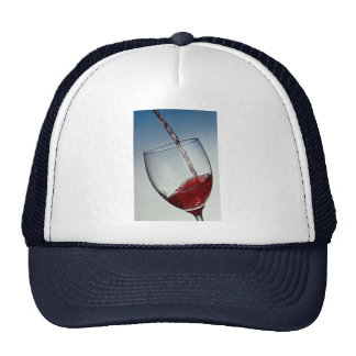 Red wine poured into wine glass hat