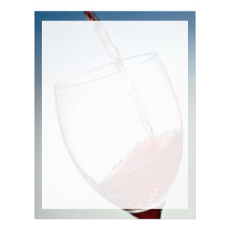 Red wine poured into wine glass letterhead