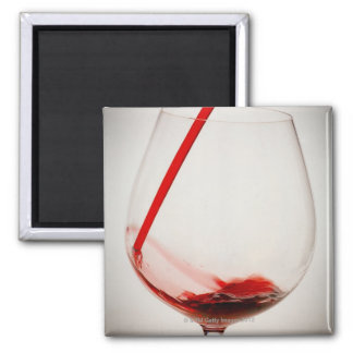 Red wine pouring into glass, close-up 2 inch square magnet