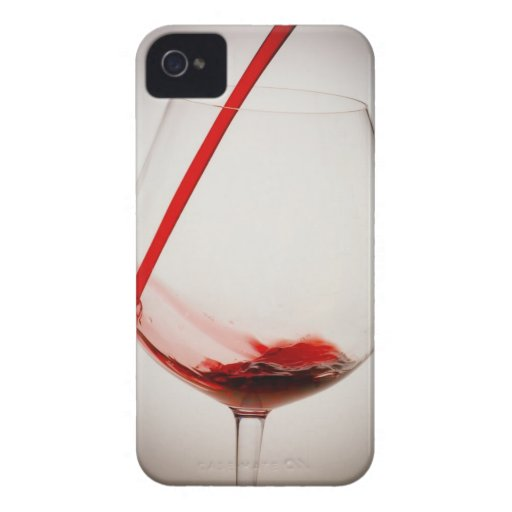 Red wine pouring into glass, close-up iPhone 4 case