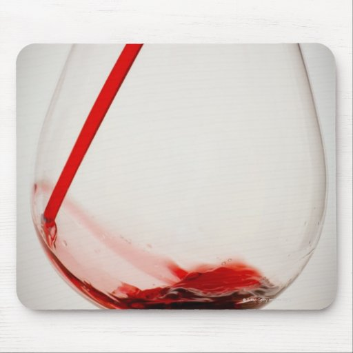 Red wine pouring into glass, close-up mouse pad