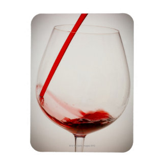 Red wine pouring into glass, close-up rectangular photo magnet
