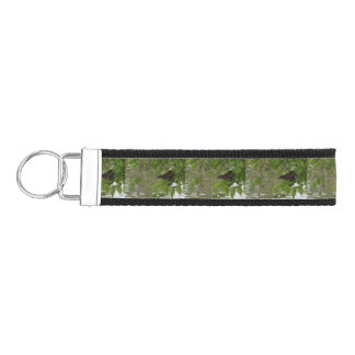 red winged black bird Fishing from a tree branch Wrist Keychain