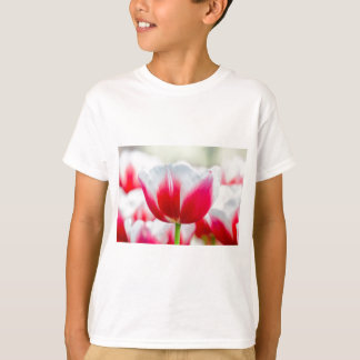 Red with white tulip in front of field T-Shirt
