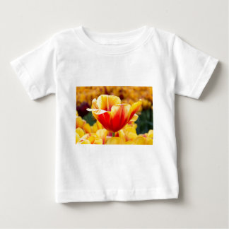 Red with yellow tulip in flowers field baby T-Shirt