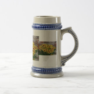 Red Yellow Flowers against brown red brick wall 18 Oz Beer Stein