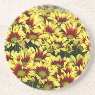 Red Yellow Flowers against brown red brick wall Beverage Coaster