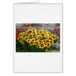 Red Yellow Flowers against brown red brick wall Greeting Card