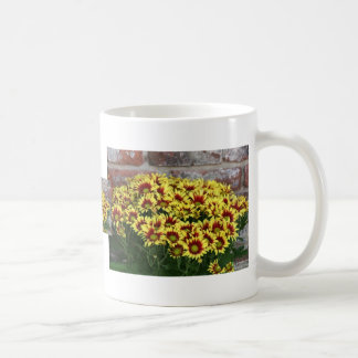 Red Yellow Flowers against brown red brick wall Classic White Coffee Mug