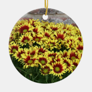 Red Yellow Flowers against brown red brick wall Double-Sided Ceramic Round Christmas Ornament