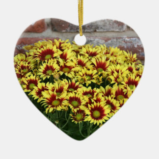 Red Yellow Flowers against brown red brick wall Double-Sided Heart Ceramic Christmas Ornament