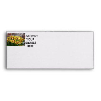 Red Yellow Flowers against brown red brick wall Envelope