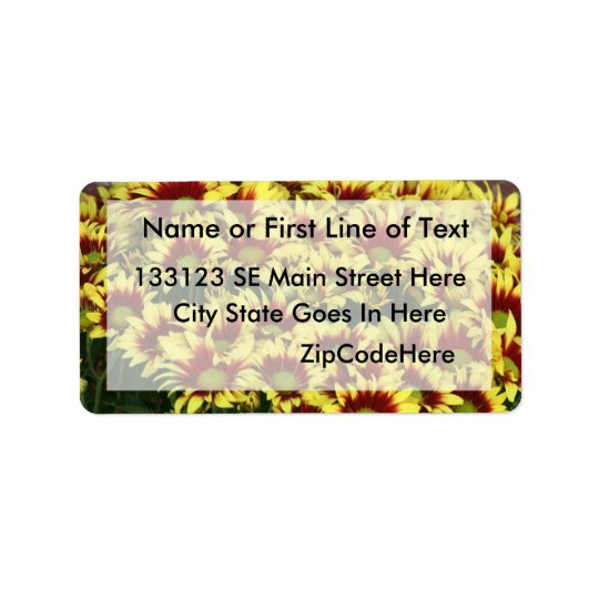 Red Yellow Flowers against brown red brick wall Label