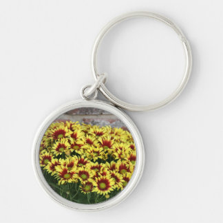 Red Yellow Flowers against brown red brick wall Silver-Colored Round Keychain