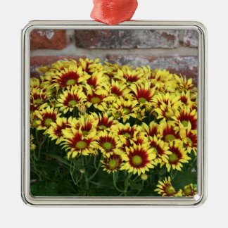 Red Yellow Flowers against brown red brick wall Square Metal Christmas Ornament