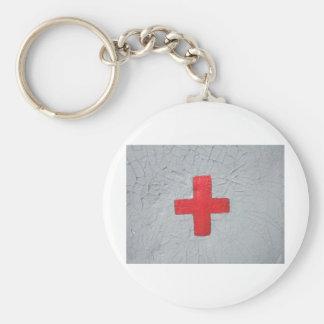 Reda cross on grey flaking paint keychain